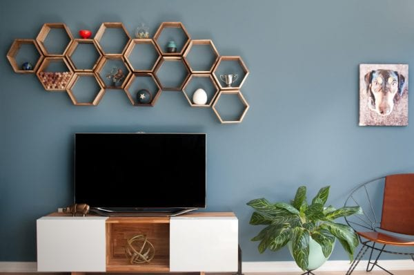 hexagonal geometric shelves above the TV (Monogram Decor)