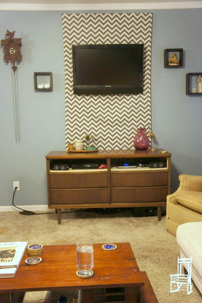 Remodelaholic 95 Ways to Hide or Decorate Around the TV  : hide TV cables with a fabric panel behind a wall mounted TV thefrontpoarch from www.remodelaholic.com size 681 x 1024 jpeg 171kB