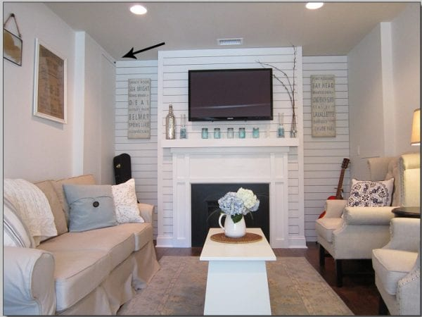 hide cable box and electronics and use an IR remote to cut TV clutter (The Honeycomb Home)
