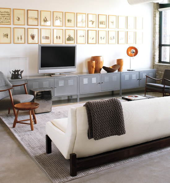 industrial living room with gallery wall above tv (Style at Home)