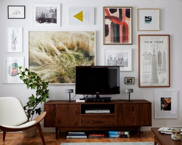large art gallery wall to hide a TV (Cup of Jo)