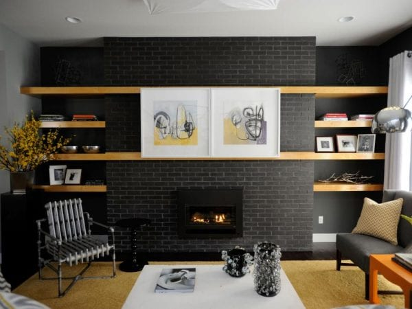 sliding artwork on floating shelves to cover the television (HGTV)