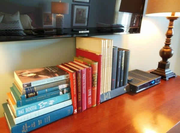 use stacks of books to hide TV cords and wires (via Love Coming Home)