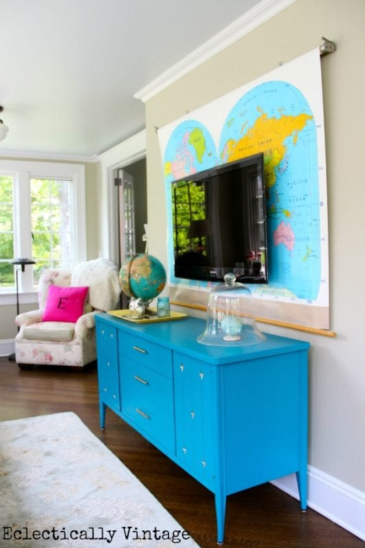 vintage dresser TV console with vintage map hung behind the TV (Eclectically Vintage)