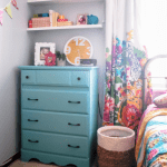 Updating a basic dresser with a bright paint job.