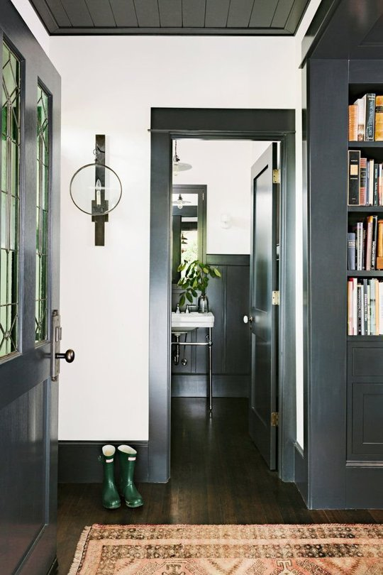 black baseboard and door trim (via Apartment Therapy)