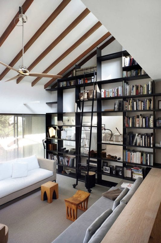 black painted tall built-in bookshelves (via A House In The Hills)