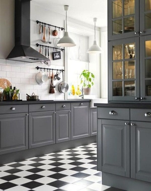 gray kitchen cabinets with black countertops (via Style Me Pretty)
