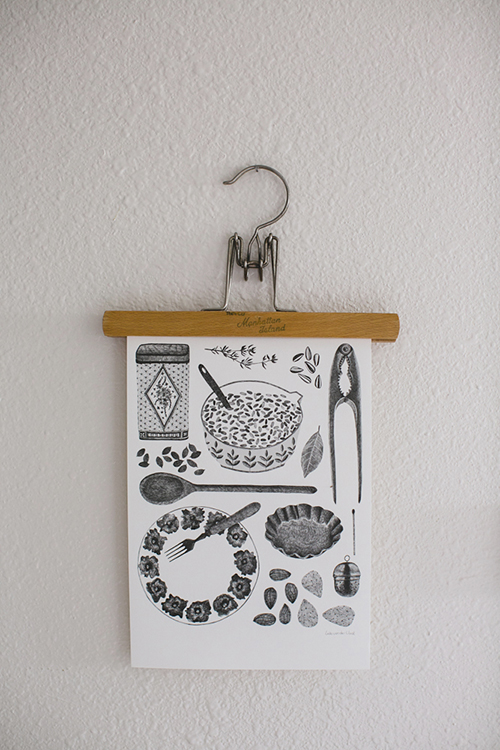 hang art prints or photos using an old pants hanger (via Apartment Therapy)