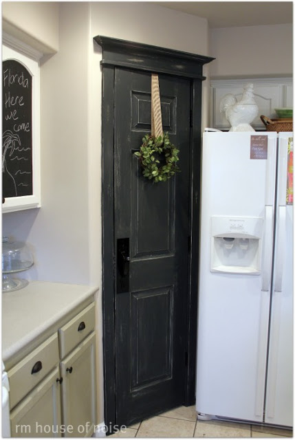 black pantry door with added trim, in Graphite Annie Sloan