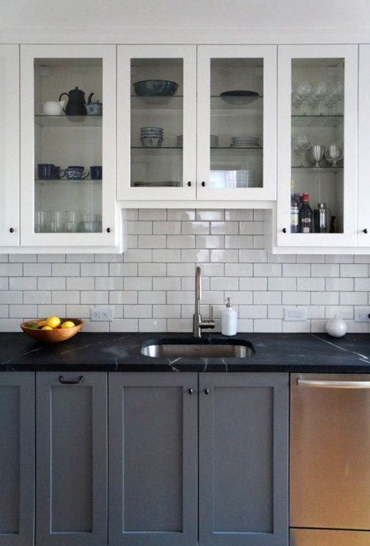 dark gray kitchen looks great with black countetops, too! (via Style