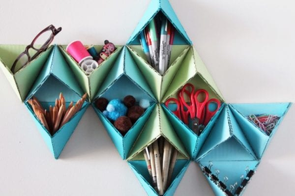 upcycled triangular storage wall (via brit-co)