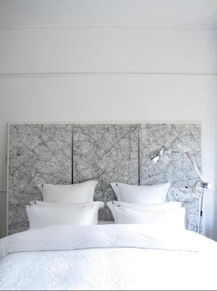 vintage maps as a headboard, could also be large wall art (via Remodelista) on Remodelaholic