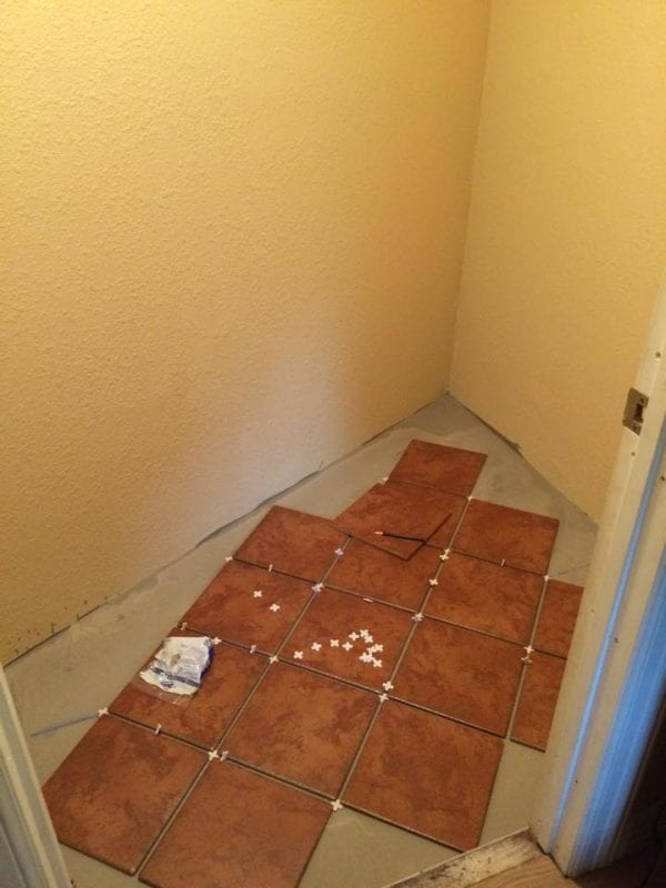 pantry makeover, installing new flooring and shelves