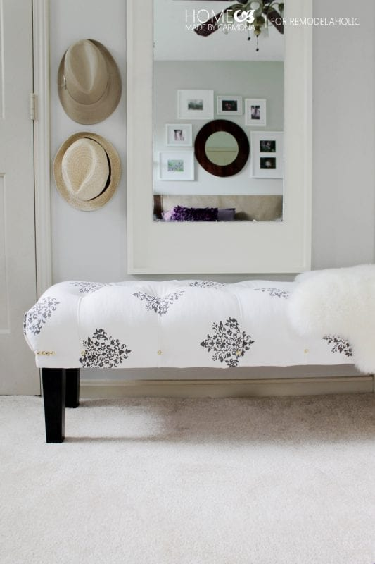 This easy-to-follow DIY tutorial walks you through building and upholstering your own tufted bench, from scratch and completely custom. Great for extra seating at the dining table or to put at the end of a bed.