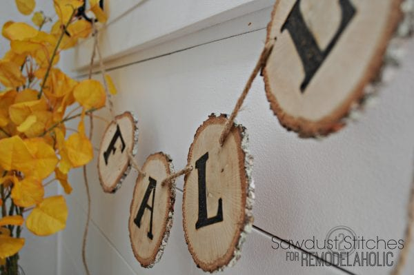 diy woodslice banner by sawdust2stitches for Remodelaholic.com