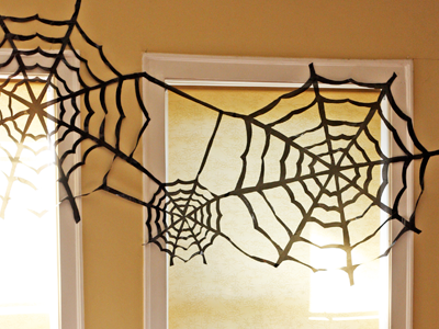 Black Plastic Bags are perfect for creating creepy spider webs for indoor or outdoor decorating - How About Orange