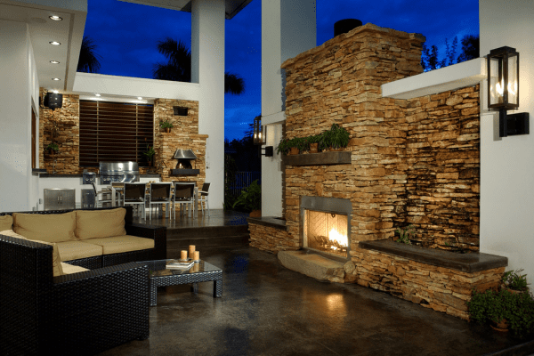gorgeous outdoor kitchen, dining room, and living room, all in one