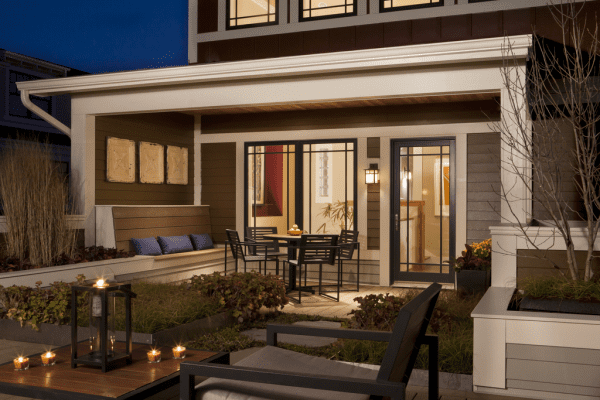 lovely porch with built-in bench seating for entertaining and outdoor dining