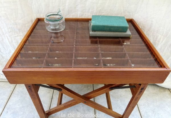 upcycled broken director's chair and cassette tape organizer into a stunning display table - In The Boondocks on Remodelaholic (6)