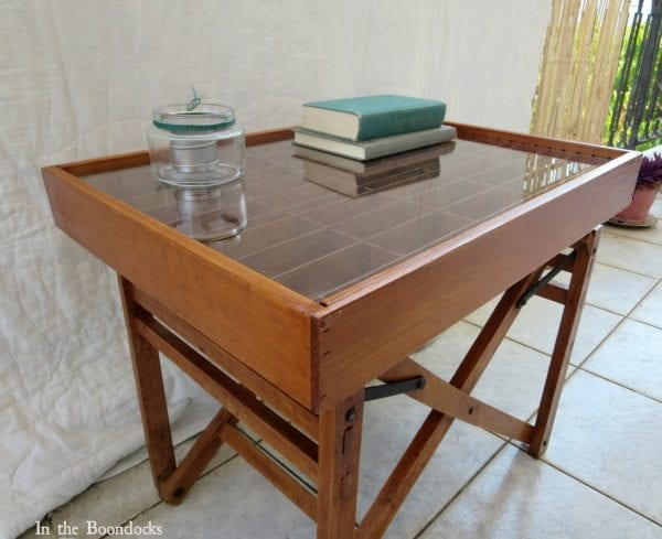 upcycled broken director's chair and cassette tape organizer into a stunning display table - In The Boondocks on Remodelaholic (7)