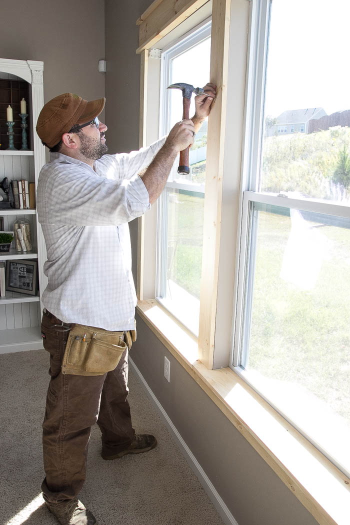 Adding DIY window trim for a craftsman look featured on Remodelaholic.com