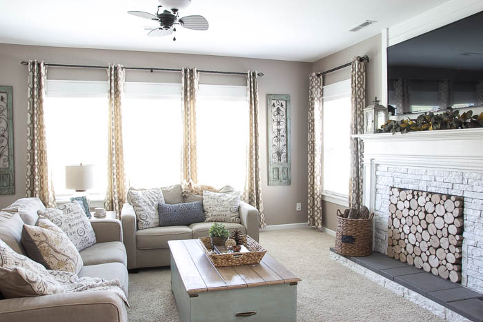 Beautiful living room featuring DIY craftsman window trim by Blesser House featured on Remodelaholic