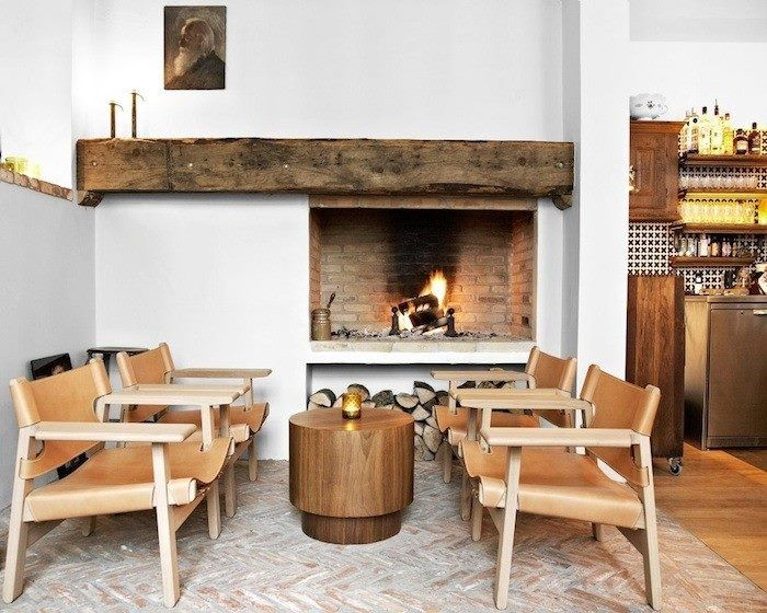 rough wood mantel for an off-center fireplace
