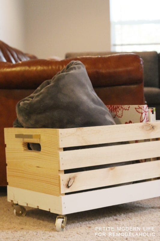 A beautiful multi-purpose storage box with gold accents that's ideal for magazines, blankets, and toys!