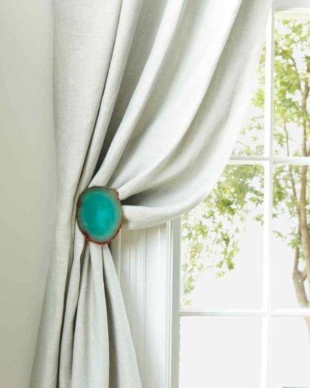 agate coasters on metal tiebacks white curtains