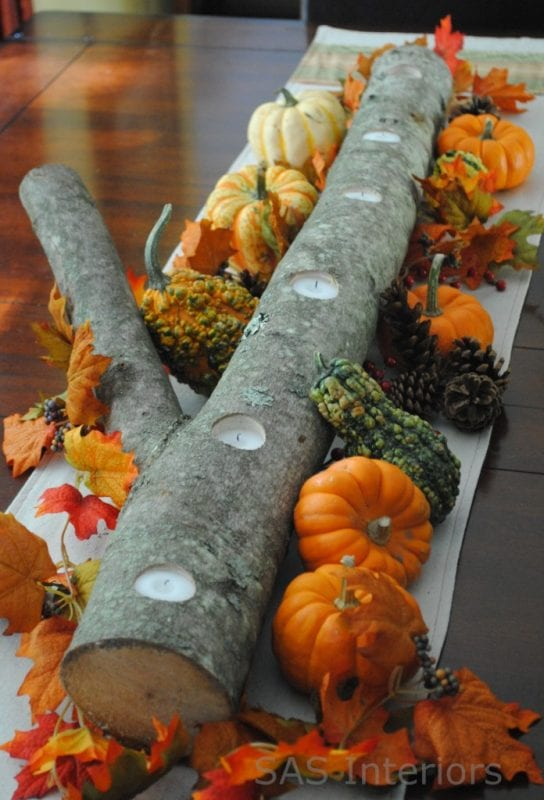 log candle centerpiece with mini pumpkins JennaBurger