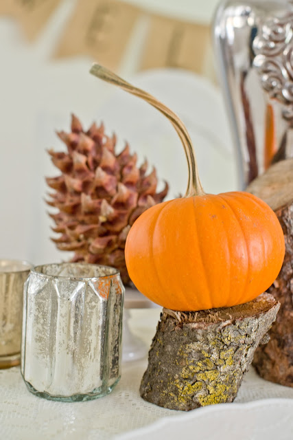 pumpkin centerpiece on cut branch Domestic Fashionista