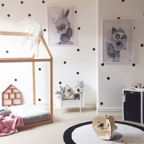 simple house floor bed frame in a girls room with polka dot walls via theposterclubkids