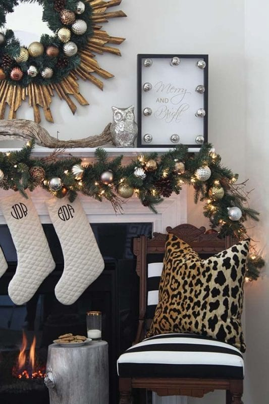 black and gold Christmas mantel