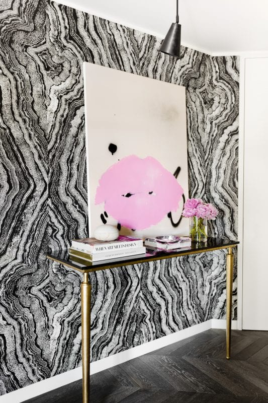 Gorgeous black and white entry with wallpaper and a pop of color (designed by Tamara Magel via @Remodelaholic)