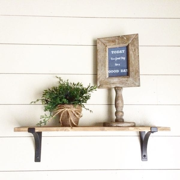 beautiful and simple rustic wood shelves with black metal brackets, Jillify It on @Remodelaholic