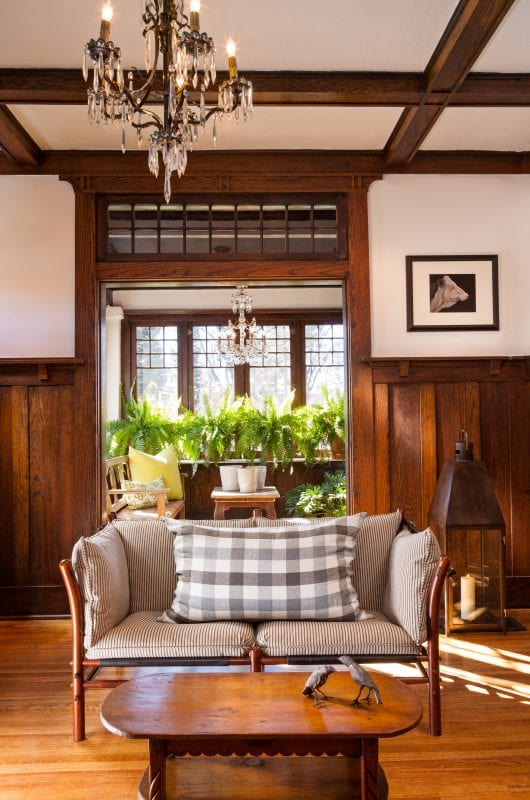 modern living room with wood paneled wainscot and coffered ceiling | by Violante & Rochford Interiors, photo credit © Wendy McEahern