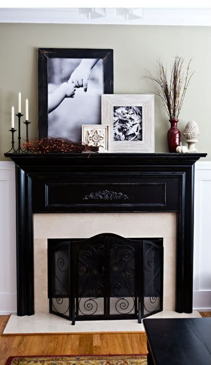 Classic black mantel with a beautiful arrangement of decor