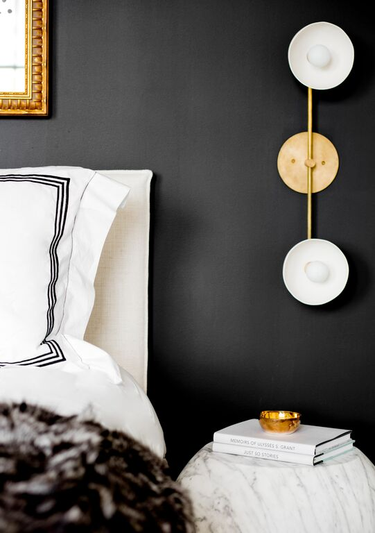 Black and white with marble and gold. That bedside lamp is amazing, and this room is gorgeous! (designed by Tamara Magel via @Remodelaholic)