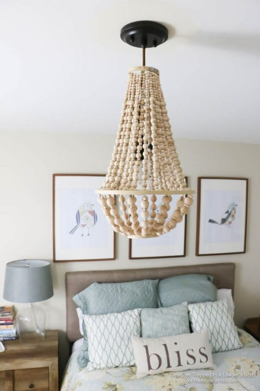 Fancy Come learn how to make your own wood bead chandelier with this awesome tutorial
