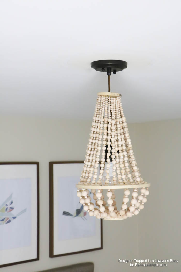 Remodelaholic how to make a wood bead chandelier come learn how to make your own wood bead chandelier with this awesome tutorial aloadofball Choice Image