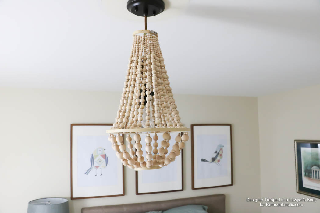 come learn how to make your own wood bead chandelier with this awesome tutorial - Wood Bead Chandelier