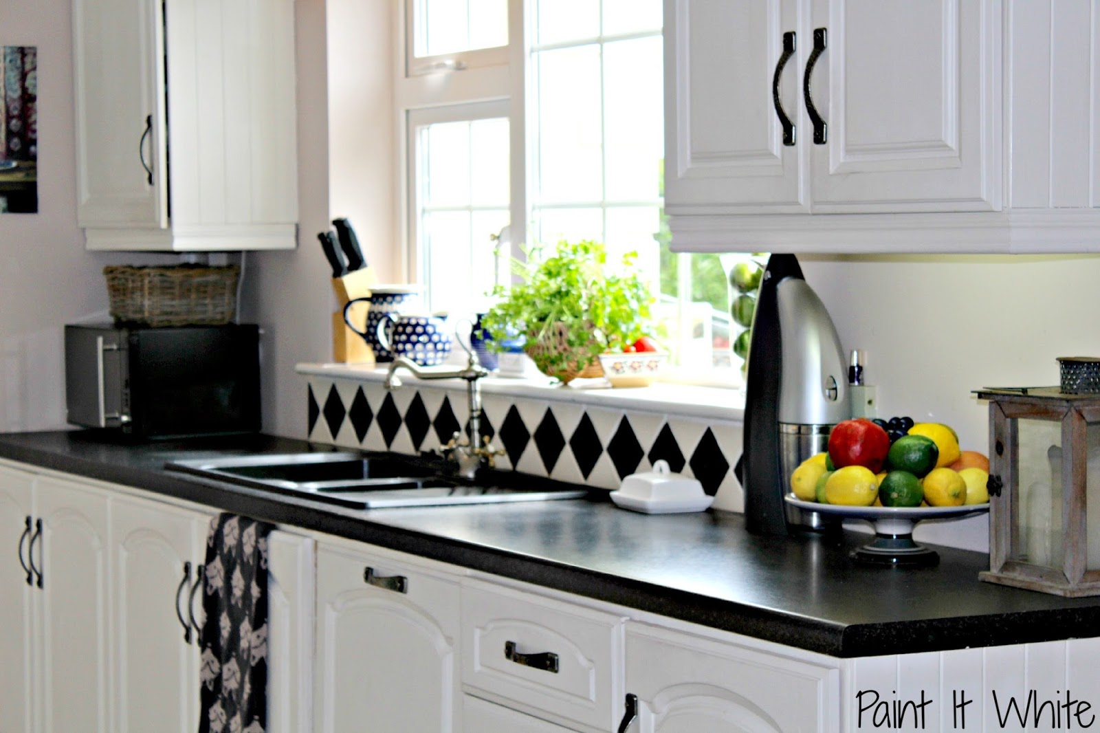1 Chalk painted cabinets in rustic white kitchen, Paint it White featured  on @Remodelaholic
