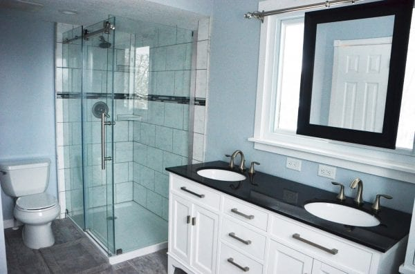 Bathroom Renovation with sliding mirror over window, dark vanity countertop over white vanity, by Since I Became a Mom featured on @Remodelohic