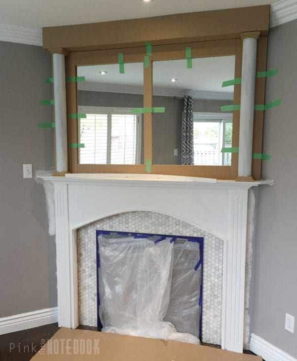 DIY mantel pillars for fireplace makeover Pink Little Notebook featured on @Remodelaholic