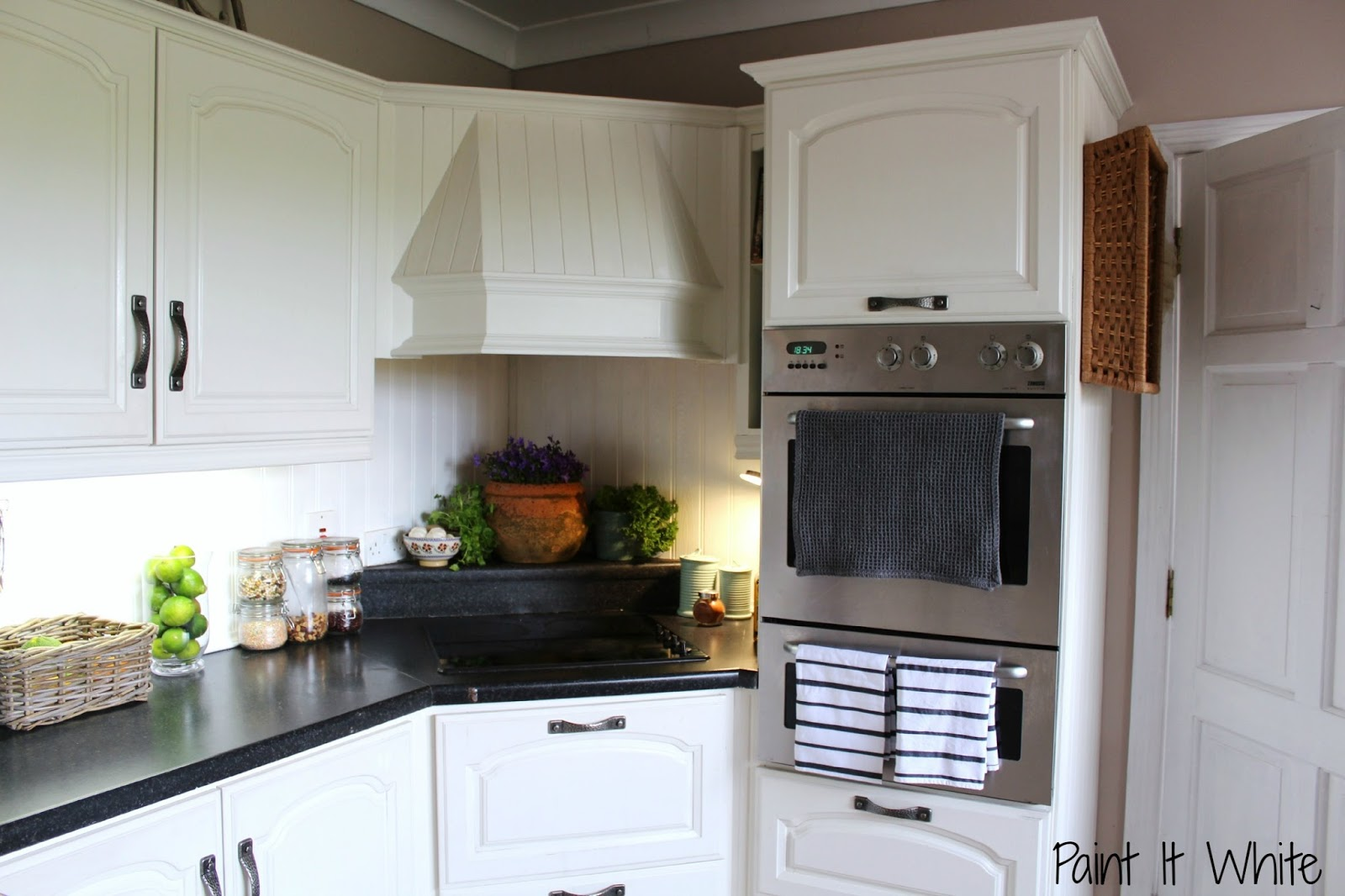 Remodelaholic beautiful white kitchen update with chalk for Chalkboard paint kitchen cabinets