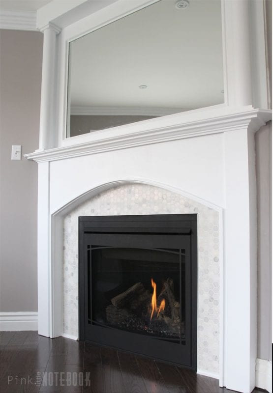 Beautiful tiled fireplace and mantel update for Building a corner fireplace