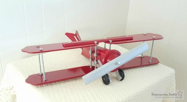16 Build decorative airplane from repurposed ceiling fan blades, front view 2, by Repurposing Junkie featured on @Remodelaholic