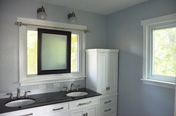 Superior Bathroom Remodel Using Sliding Mirror To Preserve Natural Light
