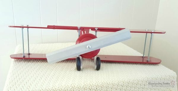 17 Build decorative airplane from repurposed ceiling fan blades, front view 3, by Repurposing Junkie featured on @Remodelaholic